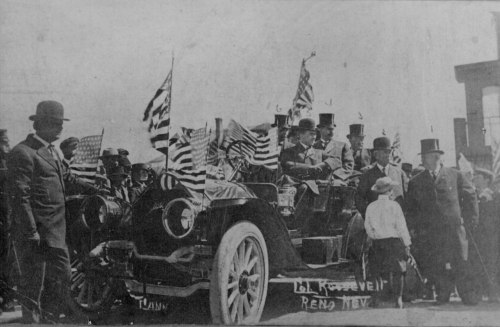 ryanshistoryblog:  Theodore Roosevelt campaigning in Reno, Nevada from an open touring car decorated with American flags, circa 1910.  From: The National Archives