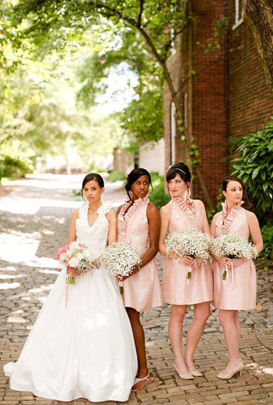 Bridal gown inspired bridesmaids' dresses! I love the silvery sheen to that pink