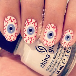 "actuallykrystan:  Eyeball nails!! I used dotting tools for the pupils and irises and a red striper for the line work. If you find that your ""iris"" (the blue) isn't looking as round as you'd like it to, go ahead and use a white striper to smooth out the lines around it."