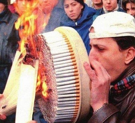 At least he's doing this with filtered cigarettes - otherwise there could be health implications.