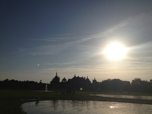 the back of Chateau de Chantilly as the sun set