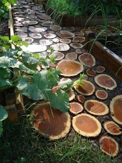 Using wood as stepping stones in your garden. Inexpensive and natural materials. Especially, like in the case of Jen and Matt from Domesticated Nomad, if you have left over woods from having trees trimmed.  Photos Cred: Domesticated Nomad.