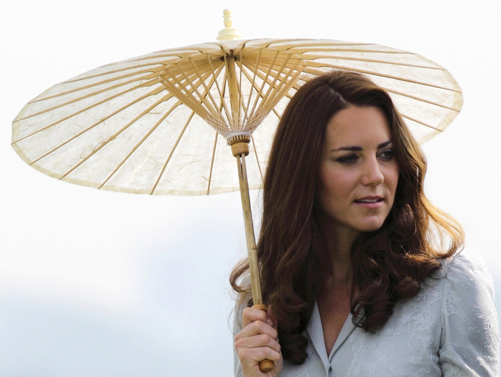 "Royals 'saddened' after topless Kate Middleton photos published in French tabloid CloserFrench magazine Closer unleashed a new media tornado on Britain's royal family on Friday with a five-page splash of photos showing the Duchess of Cambridge, Kate Middleton, sunbathing topless with Prince William in the south of France.""Their Royal Highnesses have been hugely saddened to learn that a French publication and a photographer have invaded their privacy in such a grotesque and totally unjustifiable manner,"" a spokesperson for St James' Palace said.Closer's editor-in-chief Laurence Pieau described the photos as a ""beautiful series"" that showed a couple in love and were in no way degrading. She said the magazine had more intimate shots from the same series that it opted not to publish. (REUTERS/Tim Chong)"