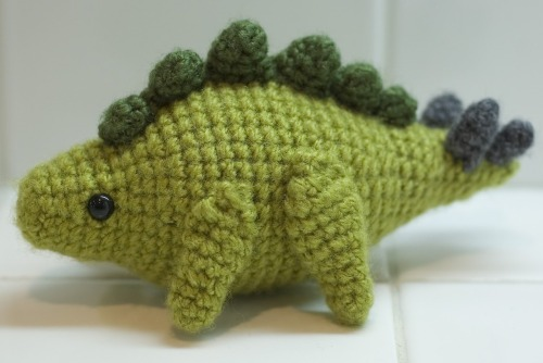 "thecatstolemypen:  hook-and-yarn:  Oh my goodness this is so cute. Pattern can be found here!  And to cut the burn of my last post have an adorable stego.     Cute lil afternoon project! I wonder what other colours would look good? Maroon with green trimmings or dark green with maroon trimmings?? .. He's cute and I'll use buttons for eyes. I have not bought that bunch of saftey eyes yet. I'm putting in my ""this weekend"" list now :) I'll get MASSIVE ones all the way down to this size :) … Then I can start designing my ""Tarsia"" amigurumi!! Using that MASSIVE saftey eyes :) Enjoy this pattern link :) Happy hookin"