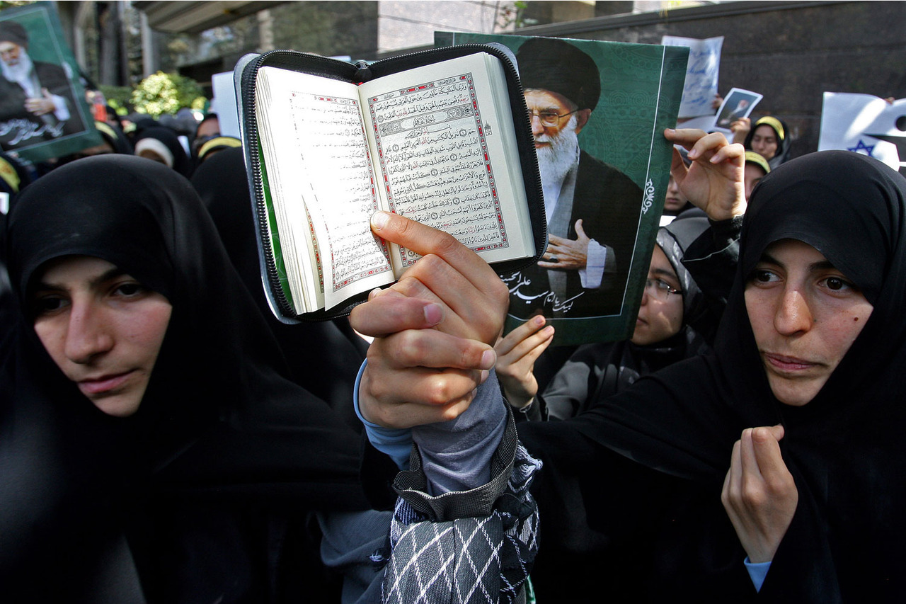 Sept. 13, 2012. Demonstrators hold up a Quran during a protest outside the Swiss embassy in Tehran. From ceremonies commemorating September 11th and attacks on U.S. Embassies around the world to the Pencil Nebula in space and playtime weightlifting in North Korea, TIME presents the best images of the week. See more photos here.