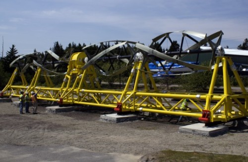 This sea-turbine is in Maine, and is the first in the U.S. It's a pilot project run by Maine Electric. Note the workers, bottom left for scale. This beast will provide electricity for only 30 homes, but more are scheduled to be built soon. poptech:  Electricity flows from ocean turbine to grid for first time in western hemisphere Tidal power went from theory to reality Thursday when, for the first time in the western hemisphere, electricity flowed from an ocean-based turbine to the electricity grid.