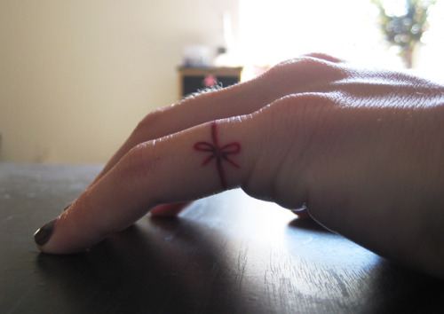 fuckyeahtattoos:  Red thread of fate on my pinky.  Done at The Locally Famous in Houston, Texas by Dave.