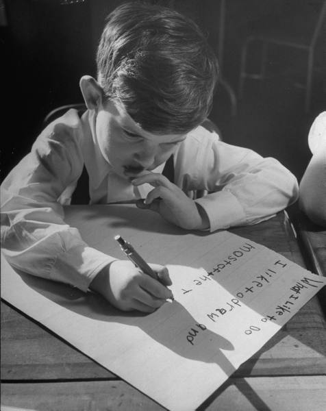 A three year old child writing about what he likes to do, circa 1948.