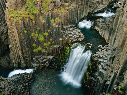 rhamphotheca:  Litlanesfoss, Iceland  Photo: Wild Wonders of Europe At Litlanesfoss, the waterfall cross-sections an ancient lava flow, which formed columns as it cooled. (via: National Geo)