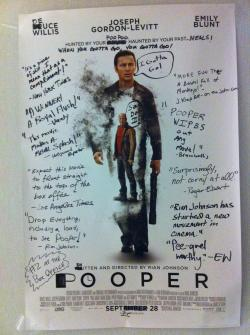 Why you should never advertise a movie in a public restroom.Looper hasn't even opened in theaters yet, but that didn't stop this workplace from mercilessly trashing its movie poster with an impressive slew of excrement-related puns and reviews. And we have to admit, we're more intrigued by their version. If they leave this up another few days, they'll either have a full script, or start tearing it apart and using it as toilet paper.Via Happy Place