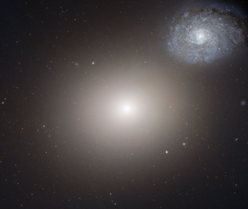 Galaxy pair called Arp 116, composed of a giant elliptical galaxy Messier 60, and a smaller spiral galaxy, NGC 4647. (via ESA/Hubble)