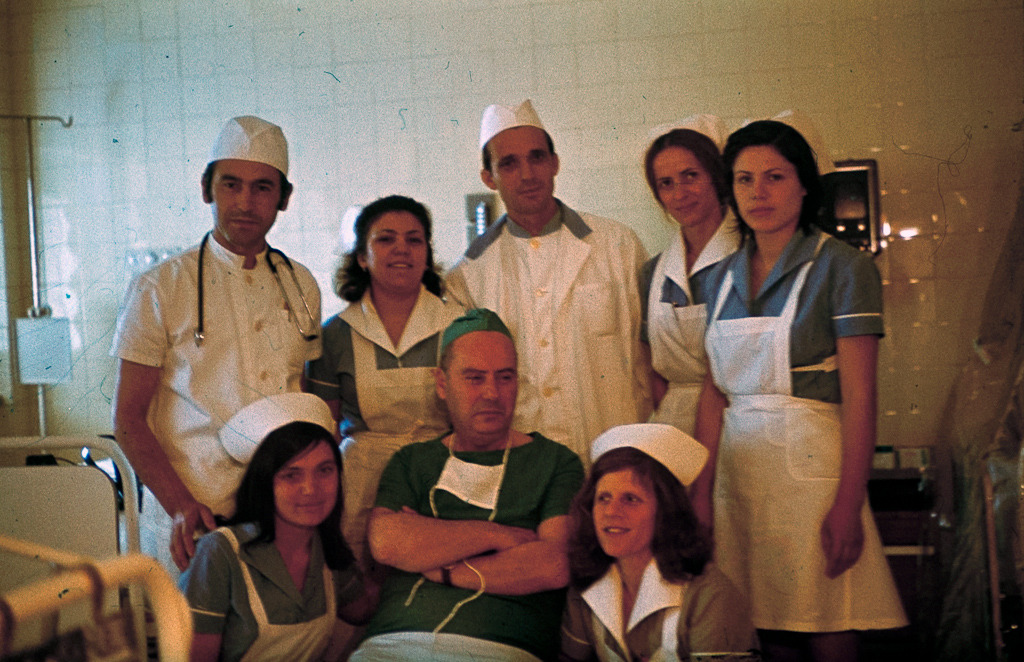 This photo shows my mom (standing second from the right) with her colleagues-nurses and a doctor or something, probably about fourty years ago. It is silly but relaxing, as if they are the only doctors ever needed and no disease is dangerous enough to take their happy faces away. During her career, beside others she worked at Infectology and Intensive Care, both departments she had to go through in the last days of her life. It's an awkward feeling to look at the picture with that in mind.