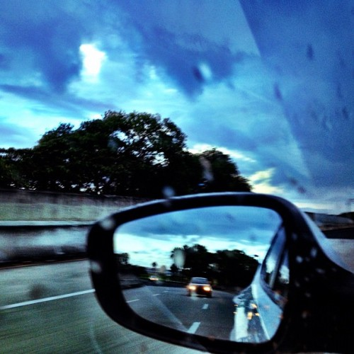 #rain #trees #reflection #sky #clouds #car #blur #igerspr #igpuertorico #hispanogram #carolina #puertorico (Taken with Instagram at Pte Teodoro Moscoso)