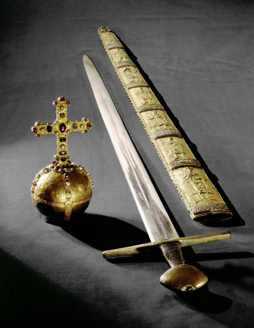 aleyma:  Imperial Orb, Sword and Scabbard of the Holy Roman Empire. The orb was made in Germany c.1200, the scabbard in Italy in the 2nd half of the 11th century, and the sword in Germany c.1198-1218. The gold panels on the scabbard depict kings and emperors from Charlemagne to Henry III.