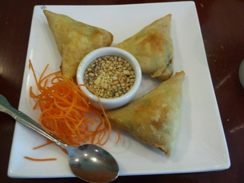 Golden triangles at Siam Lotus thai on Haight! Official version Crispy triangle crepes stuffed with mashed potatoes, & mixed peas wrapped with spring roll skins & Thai herbs & spice, served with peanut sweet & sour sauce. (how on earth is a samosa a crepe?!)
