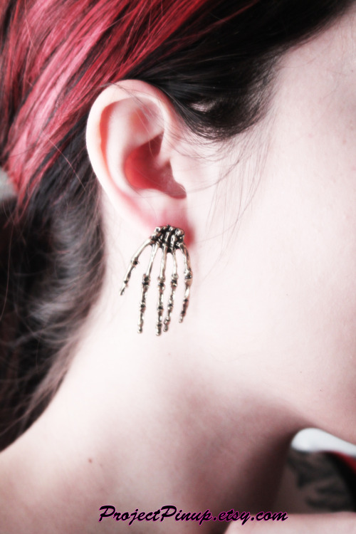 Skeleton Hand Earrings $6 Free USA Shipping in our etsy shop all this weekend! Use coupon code FREESHIP during checkout! www.projectpinup.etsy.com This is one of our newest additions ;)