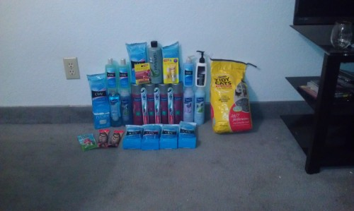 Today's haul! I spent $16.81, saved $121.55, for a total of 87% savings. Not pictured: 2 bags of M&Ms and 8 other bags of litter.
