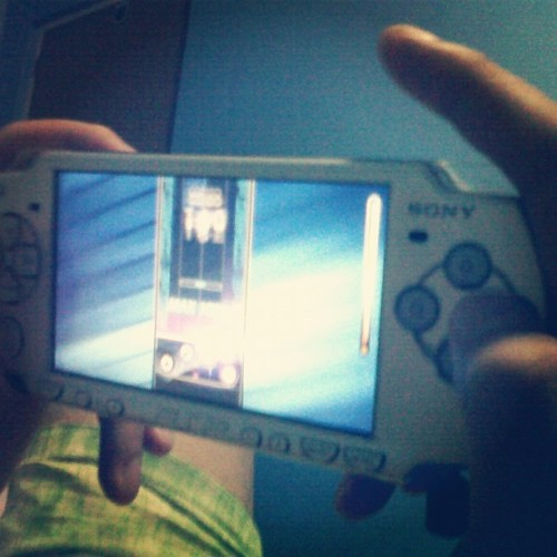 My mortal enemy: His PSP. lol  Taken with Instagram