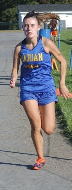 epitomeofrunning:  New favorite running picture of me. Thankyou newspaper photographers!
