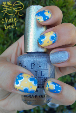 chelebee:  I really like the idea of a reverse accent nail, where every nail is full of patterns except for one.  I tried my hand at it today and it turned out looking like a Hawaiian shirt!  And, of course, my camera never seems to be able to capture the beautiful scattered holo of DS Radiance, but it's definitely there! Colors are OPI DS Radiance, OPI Ogre the Top Blue, Star Gazer Chrome, and China Glaze Lemon Fizz.