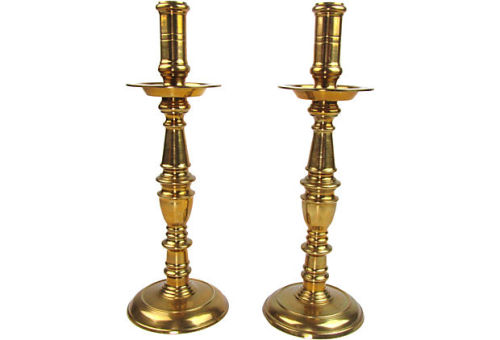 Pair of tall vintage polished brass candlesticks with round bases and turning details, each with a wax dish.  Sold on One Kings Lane Vintage & Market finds by Ruby + George.