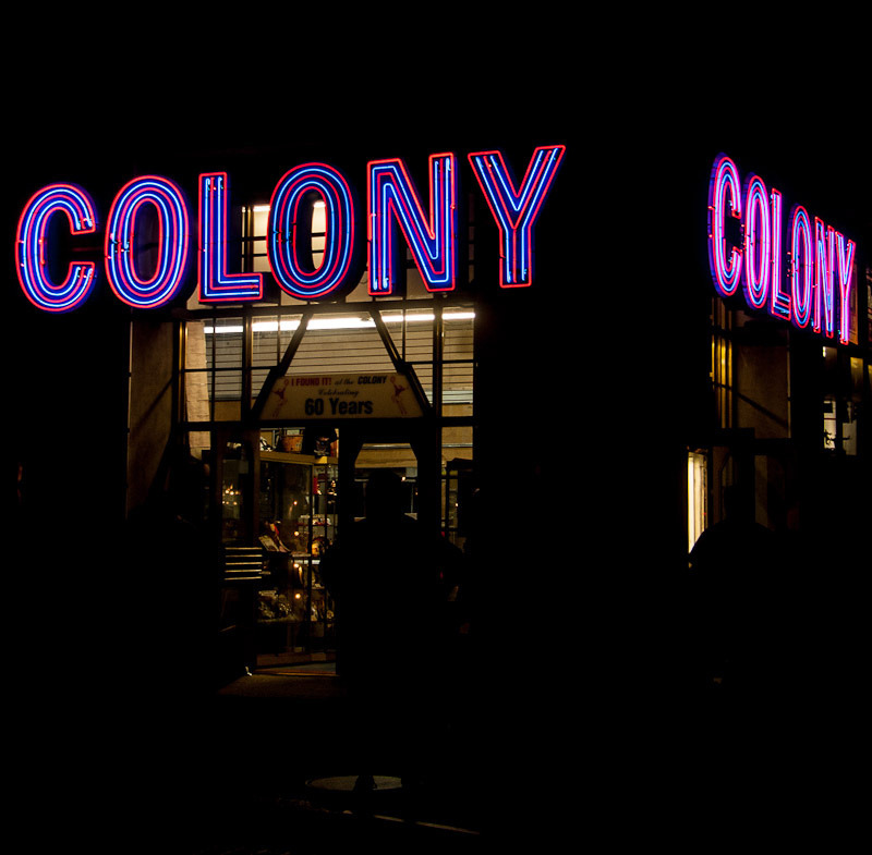 "Colony Music(In Times Square on Broadway @ 49th) RIP, Colony Music (aka Colony Records, aka The Colony, etc.) The store is giving up its corner in Times Square for an internet-only existence. Times Square is the poorer for it. When I hauled myself over there after physical therapy on Wednesday evening for one last visit, I realized it had been a long time since I've visited — making music isn't a part of my life the way it used to be. It was a trip down memory lane to be there, though. Everything from fake books to violin études that I've owned (they're probably all still in boxes somewhere here) were piled in dusty bins along with all kinds of printed music, including cheesy organ arrangements of sappy mid-century songs, marches popular in 1910, entire books of guitar music from bands I mostly really can't stand, and much, much more. Though I don't use it any more, there's comfort for me in sheet music, though I realize that makes me a bit of a dinosaur (how many people even know how to read music these days?), especially when we're talking not just about notes on staves, but about notes on staves on paper. I'd be willing to bet that the majority of what was on offer in the store is available for free on the interwebs these days.  The shop did offer some other things including music-related memorabilia, musicals on DVD, karaoke CDs, and more, but the sheet music always seemed the heart of the operation. Or really, it was the neon. The neon COLONY letters outside were still glowing strongly on Wednesday when I visited — still animated to spell the store's name out one at a time, then blink, then go dark, then start over. Which letter is your favorite? Alas, the jumping girl (""I found it at the Colony!"") who held aloft the prize vinyl she had unearthed in the store's basement record section, was already missing when I was there. Just a gap in the wall where she used to be. I wonder where she ended up? I hope she found a good home. The employees were in a somber mood, and didn't seem to welcome the many well-wishers who offered their condolences. I can't blame them — finding a job these days is harder than finding a piece of sheet music in a disorganized bin. So I purchased my copy of 42nd Street without comment and walked outside to take one last look at my favorite corner in Times Square. I could feel I was about to start crying — silly, I know, for just some glowing glass tubes and an anachronistic shop on a valuable piece of real estate, but there it was — so I turned away and descended into the subway with my photos and my memories. If there's no room for Colony in today's New York City, I can't help wondering how much longer there will be room for the rest of us dinosaurs. …………………………………………………………………………… There's a documentary about Colony in the works. You can support it here:http://www.indiegogo.com/manhattanlullaby  Plenty of people have been writing about the end of the Colony shop recently. Here are a few: http://www.nyneon.blogspot.com/2012/09/colony-record-and-radio-center.html http://www.nytimes.com/2012/08/24/nyregion/colony-records-a-longtime-midtown-music-shop-is-poised-to-close.html http://www.nytimes.com/2012/08/24/nyregion/colony-records-a-longtime-midtown-music-shop-is-poised-to-close.html http://vanishingnewyork.blogspot.com/2012/08/colony-music.html http://mbvintagenewyork.blogspot.com/2012/08/old-new-york-farewell-to-worlds-most.html http://www.nypost.com/p/news/local/manhattan/colony_closing_brakes_records_ulAC4IBEJZ4ogG2D9yKdCM"