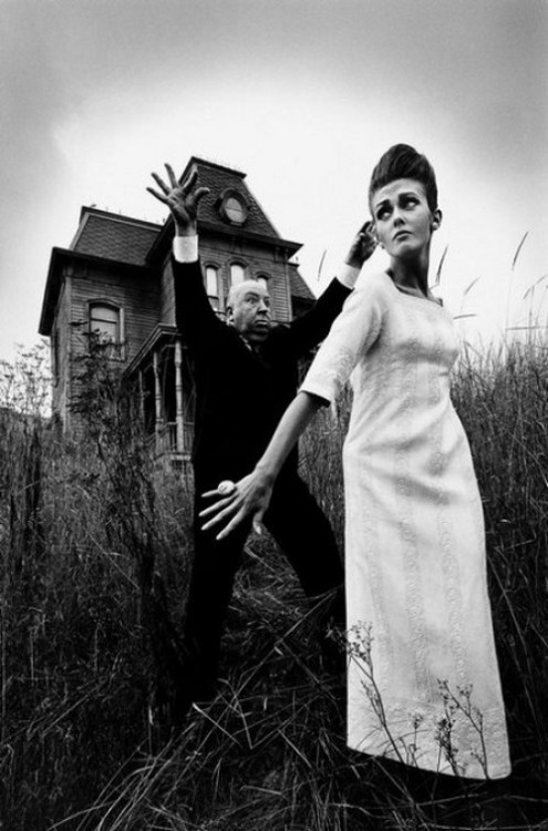 Alfred Hitchcock poses in front of the Bates' house from 'Psycho' with model Ina Balke, 1962. Photo by Jeanloup Sieff.