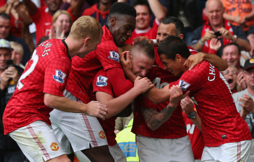 unitedlads:  Alexander Buttner celebrates with team mates after scoring the third goal