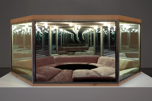 "Playroom, Paul Pfeiffer, 2012 Steel, glass one-way mirror, wood, MDF, fabric, upholstery, and lights. On view at Paula Cooper gallery in NYC until October 13th, 2012.  Pfeiffer has created a sculpture based on the ""playroom"" from legendary basketball player Wilt Chamberlain's Los Angeles mansion. Built in 1971 to Chamberlain's specifications, the mansion was widely publicized in the press as a palace dedicated to luxury and sensual pleasure. The playroom, which was paneled in mirrors and upholstered with wall to wall sofas around a fur-covered waterbed, appears here in an abstracted, open-ended version, emptied of its décor and revealing the core geometries of the design."