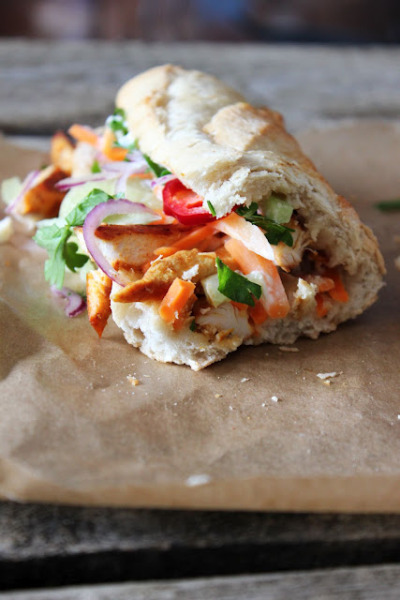 Bánh mì, vietnamese sandwich with pickled carrots, fresh cucumber, and chilli