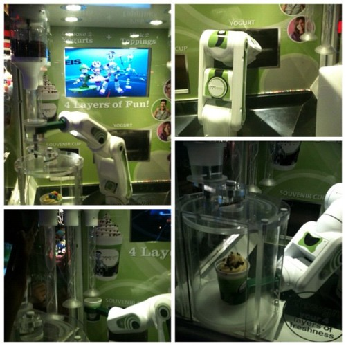 the yogurt robot at Dave & Busters….  #froyo #yum #picstitch (Taken with Instagram at Dave & Buster's)