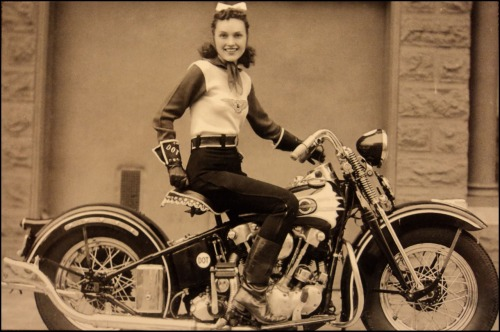 "avoir-une-faim-de-loup:  This is Dot Smith, the famous female stunt rider from the 1930s and 40s, she was a member of the San Francisco Motorcycle Club and a founding member of the iconic ""Motor Maids"" with Dot Robinson and Linda Degeau. In this photograph she's sitting on her 1937 EL Knucklehead and looking damn near perfect with that little ribbon in her hair."