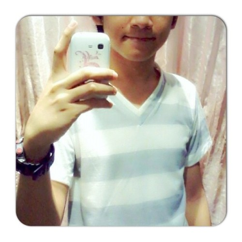 Trying on a new tee. (Taken with Instagram at Robinsons Place Tacloban)