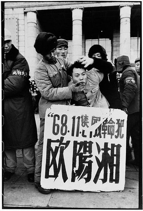 "Li Zhensheng/Contact press - Cultural Revolution China Portraits / Ouyang Xiang portrait, 1968 [***] / [***] ""Ouyang Xiang, son of the former first secretary of Heilongjiang's provincial party committee, was dragged outside the North Plaza Hotel, persecuted for sending an unsigned letter to the provincial revolutionary committee defending his denounced father. Three days later, he was pushed out of a third-story window of the building where he was held. The official report called his death a suicide. Harbin, Heilongjiang province, Nov. 30, 1968."""