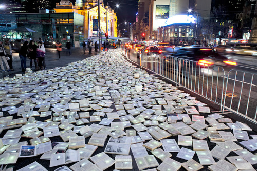 Massive River of 10,000 Discarded Books Rages Through Melbourne If you were in Melbourne this past June, you may have run into a gargantuan installation right on the city streets. For The Light in Winter festival, Spanish art collective Luzinterruptus was commissioned to create a work of art that, quite literally, stopped traffic. 10,000 discarded books, donated by public libraries and collected by the Salvation Army, were lit up and then arranged to look like a massive river overtaking the city. First created in New York, Literature vs Traffic was bigger and better this time, ultimately becoming their largest work to date.