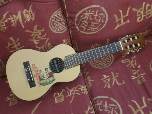 "Yamaha Guitalele. Here's Wiredandteary with a lovely little Ukulele/Guitar crossbreed, saying; ""Yamaha Guitalele with Lucky 13 graphics bought on 14/09/2012. Tuned as standard guitar capo'd at 5th fret."" It's always great to have something like this hanging around, there's something quite freeing about the lack of ego they have. We dare say more than a few heavy metal anthems have been birthed on a ukulele or nylon-strung guitar!"