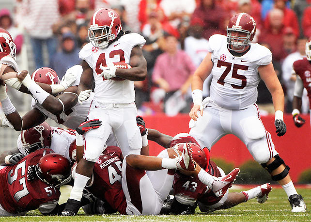 Eddie Lacy and the rest of the Alabama football squad stool tall against Arkansas in a 52-0 blowout victory on Saturday. Lacy ran for three touchdowns for the top-ranked Crimson Tide, who gained a total of 441 yards on offense. (AP) GALLERY: College Football Top 25 - Week 2STAPLES: Arkansas humiliated in blowout loss to Alabama