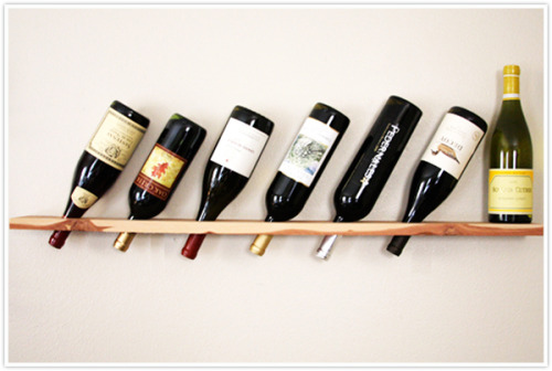DIY wood plank wine rack via Camille Styles