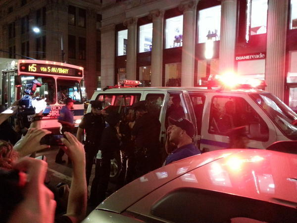 Photo Source: *Tim Pool‏@Timcast* People Being #Arrested: #Occupy #Wall #Street #NewYork An hour or so ago #Twitter started to buzz with word of arrests coming from the Occupy Wall Street event located around #Zuccotti Park and #Trinity Church. In watching live video stream #NYPD seems to be pulling random people from the crowd and off the sidewalk and putting them into police vans. They are using mega phones and a large #police presence to push the marchers out of the streets. Watch live #stream from two sources on the street. http://www.livestream.com/globalrevolution It sounds like 15-20 people have been arrested so far although there are no official numbers from NYPD as of yet. For #video from earlier this evening watch Occupy Eye http://www.ustream.tv/occupyeye