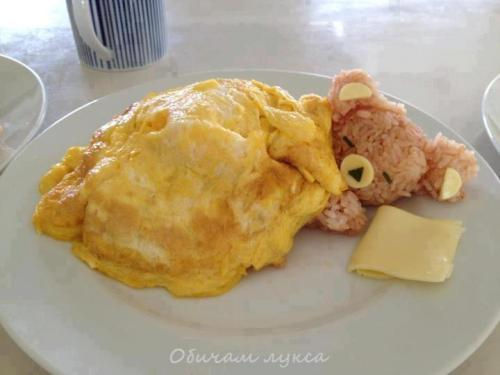 "Kawaii! We've posted some pretty cute food before, but this dish is off the charts. Are you strong enough and hungry enough to eat food this cute? This is actually the second time we've posted a teddy bear omelette. (Here's the first one) But this time, thanks to Redditor Myself91, we've learned that this adorable dish has a name. Rilakkuma Omurice or the ""Relaxing Bear Omelette"" is made using fried rice and often topped with ketchup. Here's a recipe along with an instructional video.  Unfortunately we haven't been able to figure out who made the specific dish pictured above. If you know, please tell us so we can provide proper credit. [via Reddit]"