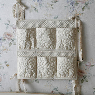 lovely wall hanging with quilted pockets