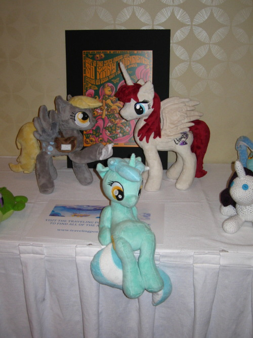 Lyra sitting with some other awesome plushies in the Traveling Pony Museum at Everfree Northwest.   I still have a few pictures saved up from Everfree, but if you have suggestions of other things you'd like to see Lyra sitting on, please post them!  I have a few old suggestions to go through, but not many.  My inbox was acting up a while back and I had to delete some of the stuff to get it working like normal again.