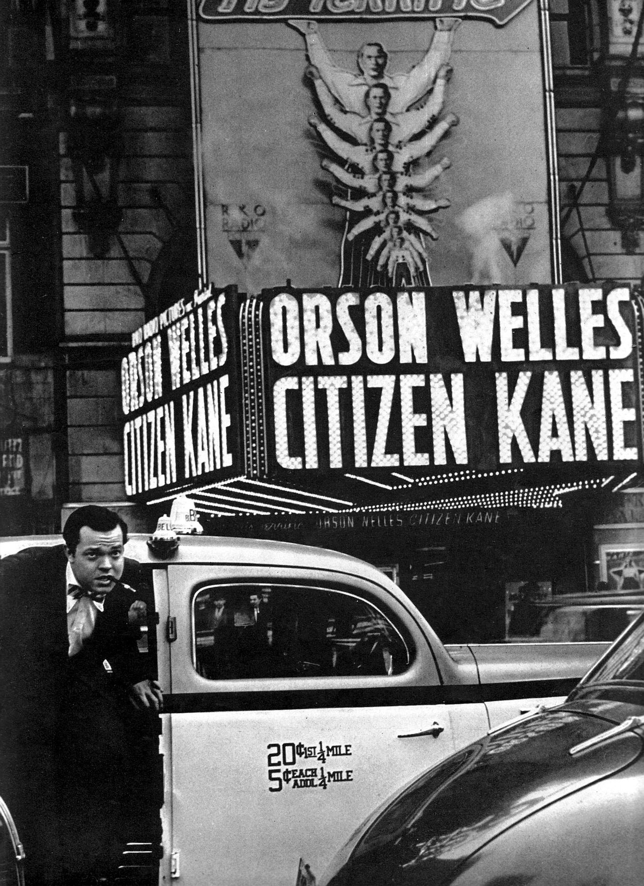 ricksginjoint:  Orson Welles arriving at the Palace Theatre for the premiere of Citizen Kane - May 1st, 1941