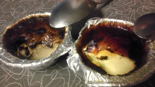sugarxlace:  Mycroft Tea Infused Creme Brulee! [image: left, mycroft chocolate brulee; right, vanilla] My dad's been bugging me for a while to make him some creme brulee and I finally had the will to do it and while I was reaching for the sugar I knocked over my bag of Mycroft blend tea from Adagio and I GUESS IT WAS JUST FATE. I'm sorry I don't have prettier dishes *dead* these are just foil muffin things. Note: For the crunchy shell top, its best to use a little butane torch, but since I don't have one, I stuck it under the broiler. This will work, but keep an eye on it. It will get WARM, and it probably won't get even color (as you can see on mine) but it tastes fine!  Recipe (makes 6-7 2oz brulees) 2 cups heavy cream plus 1/3 cup water or milk6 egg yolks (save the whites for meringue or egg white omelette because you will need to diet after eating one)6 tbs white sugar 1/2 tsp of vanilla extract (1 to 2 whole tsp if doing plain vanilla)3 tbsp Mycroft blend tea (plus or minus how strong you like it)1 tbsp cocoa powder for an extra chocolatey kick (opt)2tsp cinnamon (opt)1/2 tsp ginger (opt) Bear with me please, I go to culinary school and I have no patience for writing out every little step. I'm going to assume you have some basic knowledge of doing things, okay? Preheat: 350 degrees. Besides your whisk and ramekins or whatever, you'll also need a fairly deep oven safe dish and hot water and nerves of steel.  Heat the cream on a low flame until you can see steam beginning to waft off the top. Take off the heat and throw in your tea. Don't bother using a bag or a strainer, we're going to obsessively strain this anyway. Let it steep however long you see fit. I let mine go about two hours because I forgot it. Strain your cream. Divide your sugar in half and throw in one half with the cream and the other half with your egg yolks (in a medium bowl okay?) Whisk your egg yolks until the sugar is dissolved. When the cream is steaming again, pour a little at a time into the egg mixture, whisking the whole time. Add your vanilla and other flavorings now and beat thoroughly. STRAIN THIS VERY, VERY WELL. Strain it two, even three times, cleaning out your sieve very well after each pass. You want a smooth texture custard. No lumps or grit. Pour into your little dishes (i used a measuring cup with a pouring spout for this) and move them into your deep dish. Put them in the oven but just before closing up, add the hot water the bottom of the pot, about halfway up the sides of the cups. You can cover the top with foil, but I didn't because I'm lazy and they came out fine. Let them bake for 20 to 30 minutes, but check on them 15 minutes in. They're done when you shake the pan and the custard jiggle like jello but don't ripple like water. Be very fucking careful taking that pan out of the oven because that water will blister your skin off. Let it cool for 15 minutes in the water, then take them out and stick in the fridge for a few hours. For the top, use granulated white sugar or even a white + brown sugar mixture, but it has to be smooth granulation. No big crystals. Then either torch it or stick in the broiler for a minute. If you broil them, put them back in the freezer for a couple minutes to chill it again. notes Its important that sugar goes in both your cream and your eggs because it'll protect them from burning. Don't put the sugar in your eggs until they're ready to go in, because they will get gritty and gross while the sugar pulls out the moisture and leaves behind curds. If you're not comfortable with making custards yet, use a 1/4 cup and gradually add and whisk in the cream to the eggs one cup at a time. You probably won't get it smooth each time, but thats okay. The consistency of this brulee is more like pudding because we only used yolk. If you want something a little firmer, you can substitute two yolks for one whole egg. I don't do this because I think it makes the brulee taste really eggy and any little overwarmed spot will reek of sulfer ew. NOW GO EAT YOUR DAMN CAKE CREME BRULEE