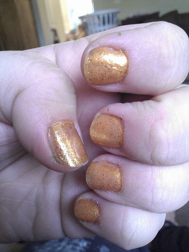 30 Day Nail Challenge Day 2 - Orange Base: SH Hard as Nails Color: Sally Girl, some shimmery orange Glitter: Spoiled Colors (from CVS), gold Top: SH Double Duty  It didn't hold up very well, but I think that may have been because of the top coat.  It's kind of old, and the bottle is almost empty to the point of not being able to reach anymore.  Looks like I'm going to have to get a bottle of Seche Vite and see what the big deal is.