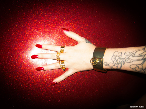 claytoncubitt:  Posh's red nails and gold cuffs, NYC   (3938)