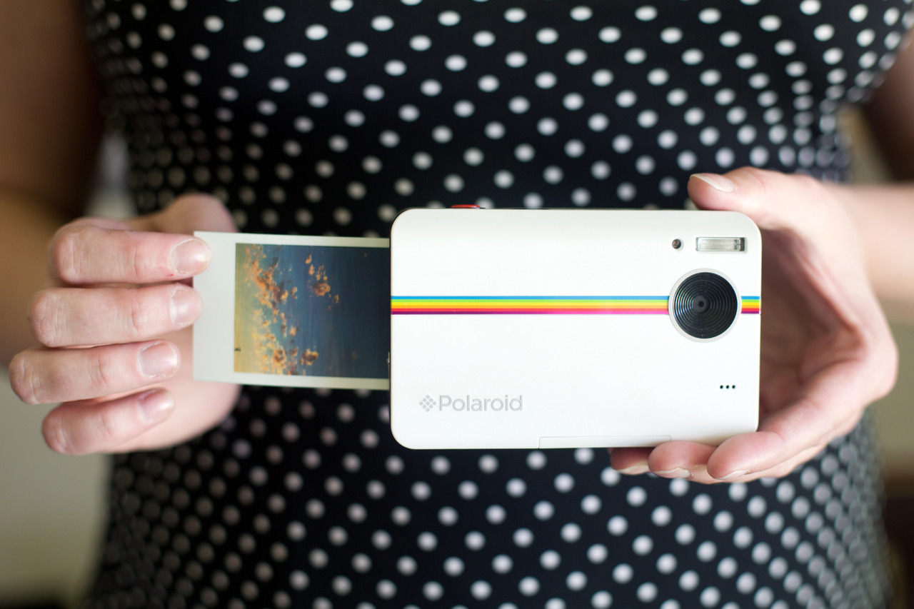 untitled-mag:  What did Polaroid find when they looked into our digital-analog-loving soul?  The Polaroid Z2300.  It shoots digital photos at 10MP, and instantly prints them straight from the camera. The instant prints come with sticky backs, so you can stick your photos in your notebook or on your BFF's FACE.
