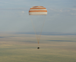Landing of Expedition 32 The Soyuz TMA-04M spacecraft is seen as it lands with Expedition 32 Commander Gennady Padalka of Russia, NASA Flight Engineer Joe Acaba and Russian Flight Engineer Sergie Revin in a remote area near the town of Arkalyk, Kazakhstan, on Monday, September 17, 2012. Padalka, Acaba and Revin returned from five months onboard the International Space Station where they served as members of the Expedition 31 and 32 crews. Photo Credit: (NASA/Carla Cioffi)