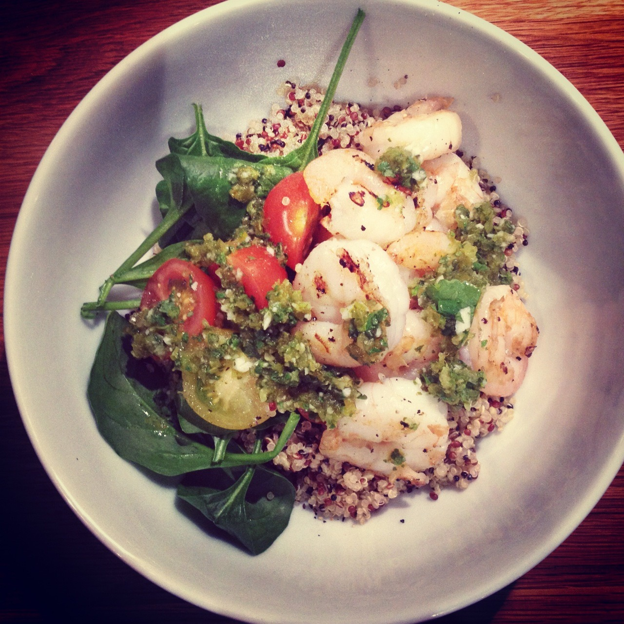 Grilled prawn quinoa salad with jalapeno dressing two cups cooked quinoa (follow instructions or read our quinoa section on the blog) five hundred grams green raw prawns/shrimps, peeled with tail intact olive oil, for brushing sea salt and cracked black pepper  two hundred grams mixed cherry tomatoes, halved hundred grams spinach or rocket leaves jalapeno dressingone tablespoon lime juice two teaspoons finely grated lemon rind one cup chopped coriander leaves two cloves of garlic, crushed one quarter cup chopped store-bought pickled jalapenos two tablespoons jalapeno brine (that is the `juice` they were pickled in) one// To make the jalapeno dressing, place the lime juice, lime rind, coriander, garlic, chopped jalapeno and jalapeno brine in a processor and process until roughly chopped. Set aside. two// Preheat a char-grill pan or bbq over high heat. Brush the prawns with oil and sprinkle with salt and pepper. Cook the prawns for two minutes each side or until cooked through. Place the quinoa in a bowl with the tomato, spinach and prawns and drizzle with the dressing. Serves four.