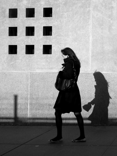 A young woman followed by her shadow…Battery Park City, NYC (via Cornelis Verwaal)